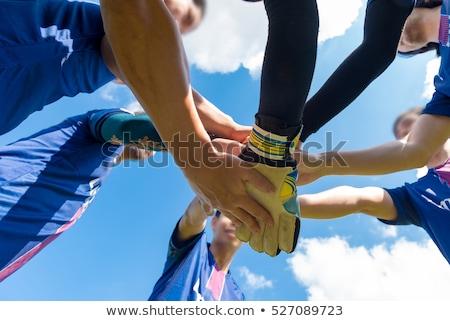 Fiatal futball játékosok futball csapat barátok Stock fotó © matimix