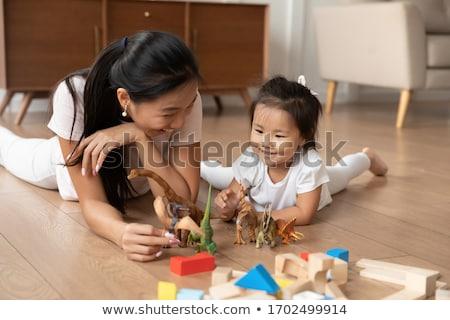 Boldog kislány játszik játék dinoszaurusz otthon Stock fotó © dolgachov