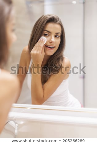 Mirror Close-Up Of Young Woman Applying Make-Up For Beauty Stock photo © diego_cervo