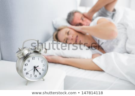 Couple Covering Their Ears With Pillow On Bed Stock photo © AndreyPopov