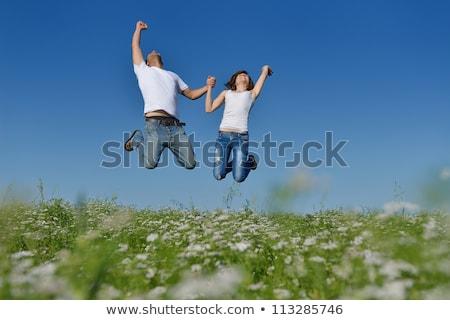 прыжки луговой улыбка трава человека Сток-фото © Lopolo