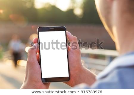 üzletember mobiltelefon szabadtér iroda óra üzlet Stock fotó © szefei