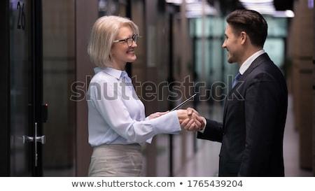 Uśmiechnięty dojrzały biznesmen uścisk dłoni kobiet kandydat Zdjęcia stock © AndreyPopov