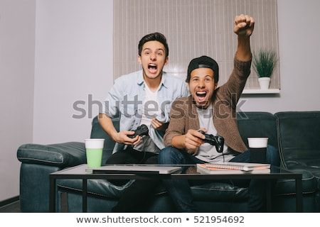Garçon célébrer victoire ordinateur jeu vidéo technologie Photo stock © dolgachov
