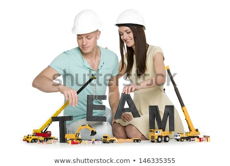 Forming a team: Cheerful man and woman building team-word. Stock photo © lichtmeister