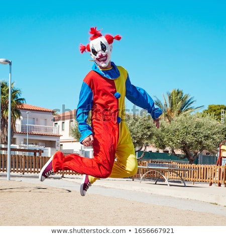 scary clown jumping outdoors Stock photo © nito