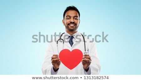 Uśmiechnięty indian mężczyzna lekarz czerwony kształt serca muzyka Zdjęcia stock © dolgachov