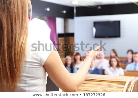 Rear view of  Caucasian female speaker speaks with microphone to diserve business people in a busine Stock photo © wavebreak_media