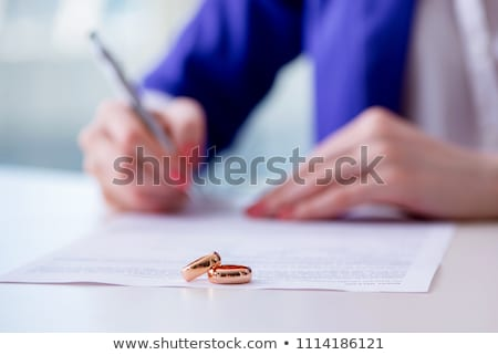 Woman signing prenuptial agreement in court Stock photo © Elnur