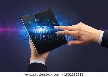 бизнесмен смартфон безопасности Сток-фото © ra2studio