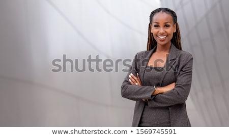 Profissional mulher negra em pé escritório dobrado brasão Foto stock © boggy