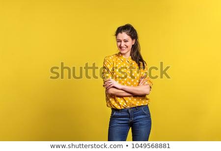 beautiful women in a yellow shirt Stock photo © Lupen