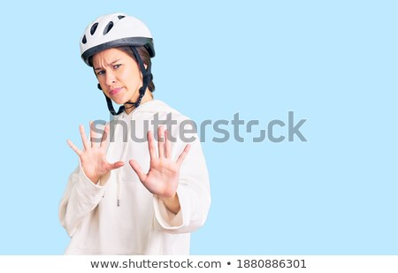 Woman with helmet and face of disgust Stock photo © photography33
