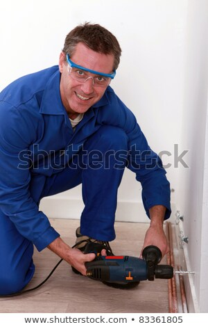 plumber using a drill to install copper pipes stock photo © photography33