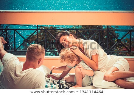 Mother and son playing checkers Stock photo © photography33