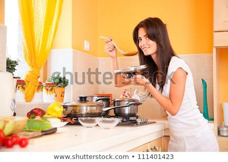 woman in a kitchen eating paprika Stock photo © Rob_Stark
