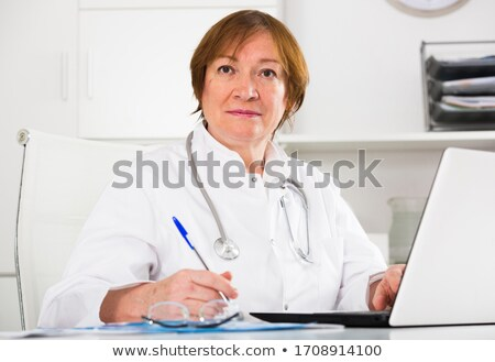 Female practitioner ready to assist senior doctor Stock photo © stockyimages
