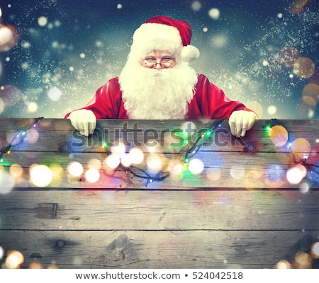 merry christmas santa claus holding wood sign stock photo © benchart