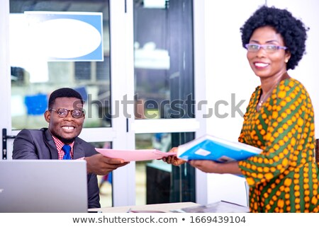 A businessman handing over his glasses. Stock photo © photography33