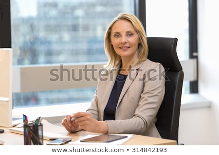 Cute blond business woman on white stock photo © dash