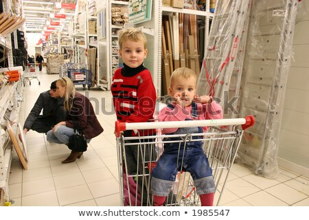 Stock photo: children in shopingcart and couple
