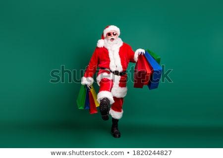 Jolly Shopaholics Stock photo © luminastock