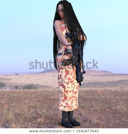 Young beautiful female soldier dressed in a camouflage with a ri Stock photo © vlad_star