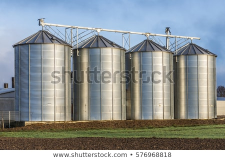silo in beautiful landscape with dramatical light placed in plouged acres stock photo © meinzahn