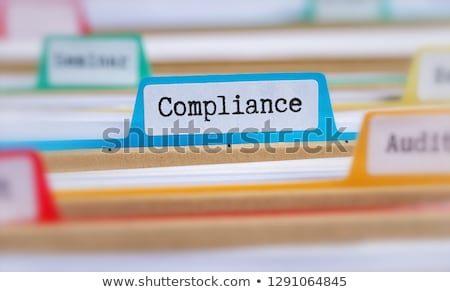 hanging file folder labeled with regulations stock photo © zerbor