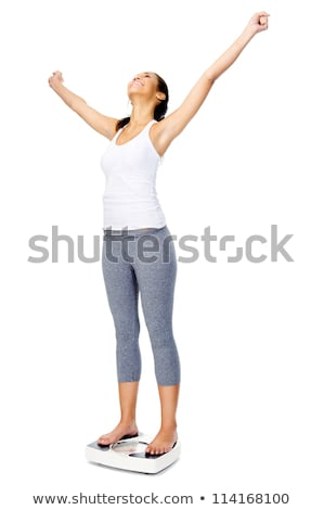 Happy Woman Standing On Weighing Scale Stock photo © AndreyPopov
