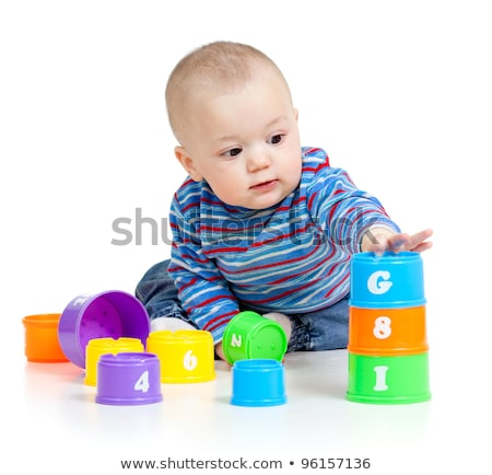 baby is playing with toys over white background funny little k stock photo © ewastudio
