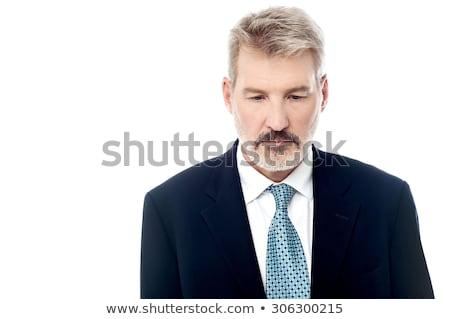 bearded business man looking down stock photo © feedough