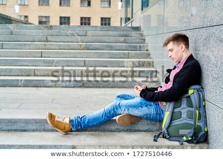 Plecak cyfrowe nastolatek stałego słuchania Zdjęcia stock © ambro