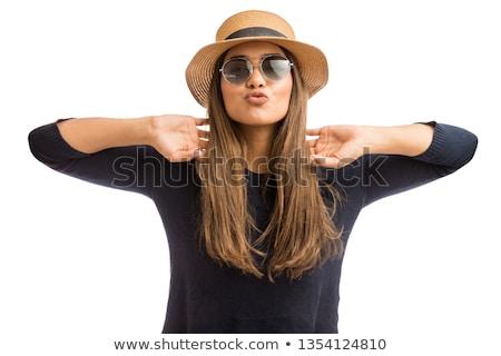 Woman puckering. Stock photo © iofoto