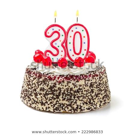 Bolo de aniversário ardente vela número 30 bolo Foto stock © Zerbor