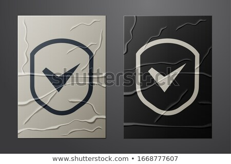 Check Mark Icon on Crumpled Paper Texture Stock photo © pashabo