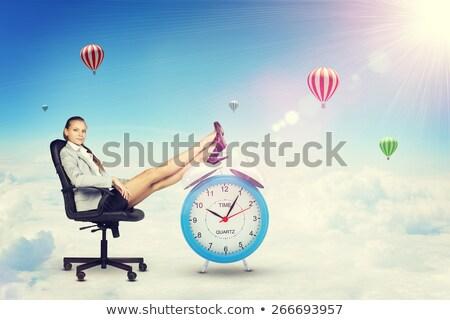 donna · capelli · lunghi · seduta · sedia · guardando · sole - foto d'archivio © cherezoff