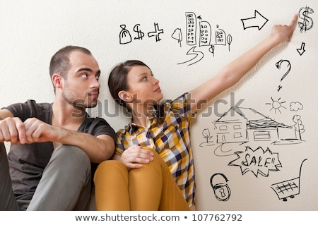 Young couple planning their future at new home Stock photo © HASLOO