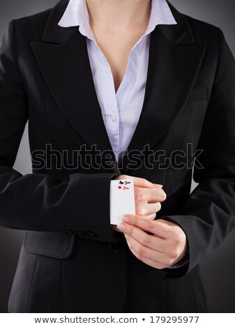 businesswoman with playing cards hidden stock photo © andreypopov
