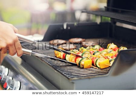 Grilling food on an outdoor gas barbecue Stock photo © ozgur