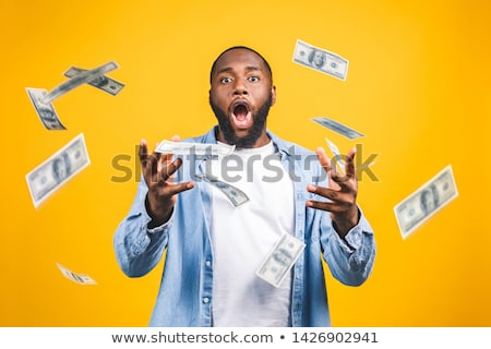 portrait of a happy young afro american businessman stock photo © deandrobot