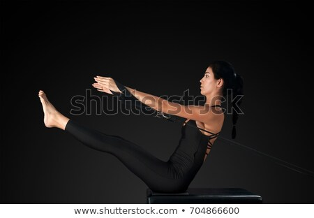 Pilates woman in reformer teaser exercise at gym Stock photo © lunamarina