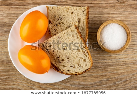close up of white salt cellar on wooden table Stock photo © dolgachov