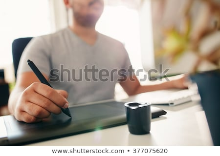 Table of graphic designer using pen tablet with stylus Stock photo © deandrobot