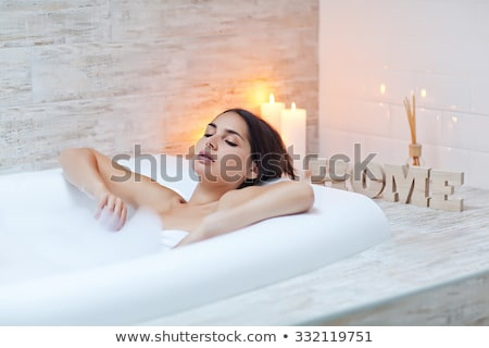 brunette beauty takes a bath stock photo © konradbak