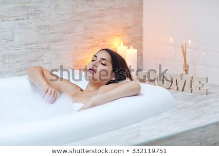 Brunette beauté bain fille lumière détendre Photo stock © konradbak