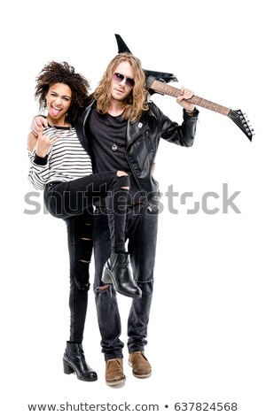 rock and roll couple standing embraced Stock photo © feedough