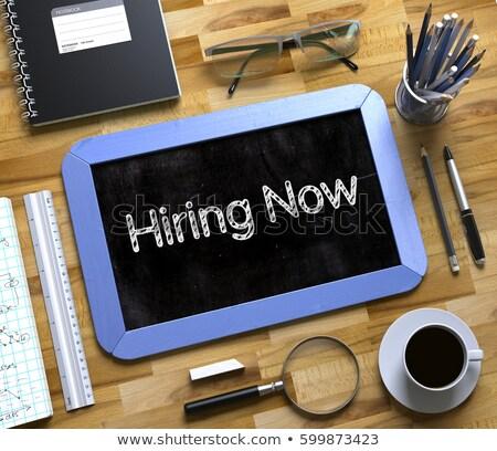 hiring now concept on small chalkboard 3d stock photo © tashatuvango