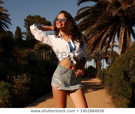 Mutlu güzel bir kadın karanlık mavi etek beyaz Stok fotoğraf © julenochek