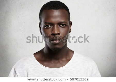 Close up portrait of serious african man looking at camera Stock photo © deandrobot
